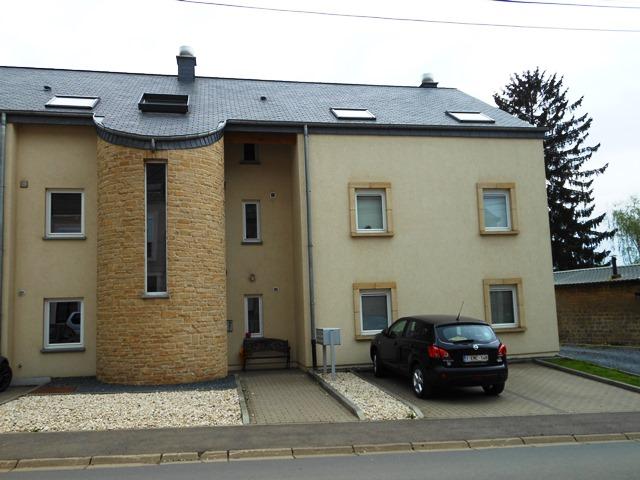 HALANZY- Rez-de-chaussée 2 chambres, jardin et terrasse, emplacement de parking extérieur